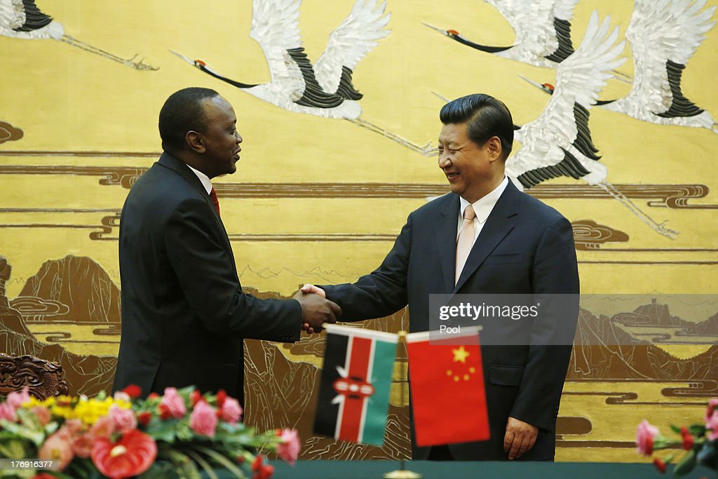 Kenyan President <a gi-track='captionPersonalityLinkClicked' href=/galleries/search?phrase=Uhuru+Kenyatta&family=editorial&specificpeople=2149190 ng-click='$event.stopPropagation()'>Uhuru Kenyatta</a> (3rd L) and his Chinese President <a gi-track='captionPersonalityLinkClicked' href=/galleries/search?phrase=Xi+Jinping&family=editorial&specificpeople=2598986 ng-click='$event.stopPropagation()'>Xi Jinping</a> (3rd R) shake hands during a signing ceremony for a visa exemption agreement in the Great Hall of the People August 19, 2013 in Beijing, China. The agreement between the two countries will allow mutual visa exemptions for holders of diplomatic service passports.