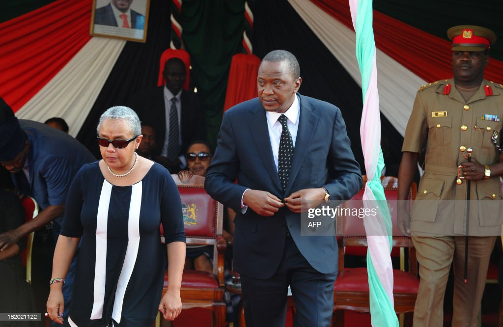Kenyan President Uhuru Kenyatta and his wife Margaret attend the funeral service of his nephew Mbugua Mwangi and his fiancee Rosemary Wahito in Nairobi on September 27, 2013 after they were both killed in the Westagte Mall attacks. Kenyan and foreign forensics teams scoured the wreckage of a Nairobi shopping mall for bodies and clues after a four-day siege by Islamist gunmen left 67 dead and dozens more missing.