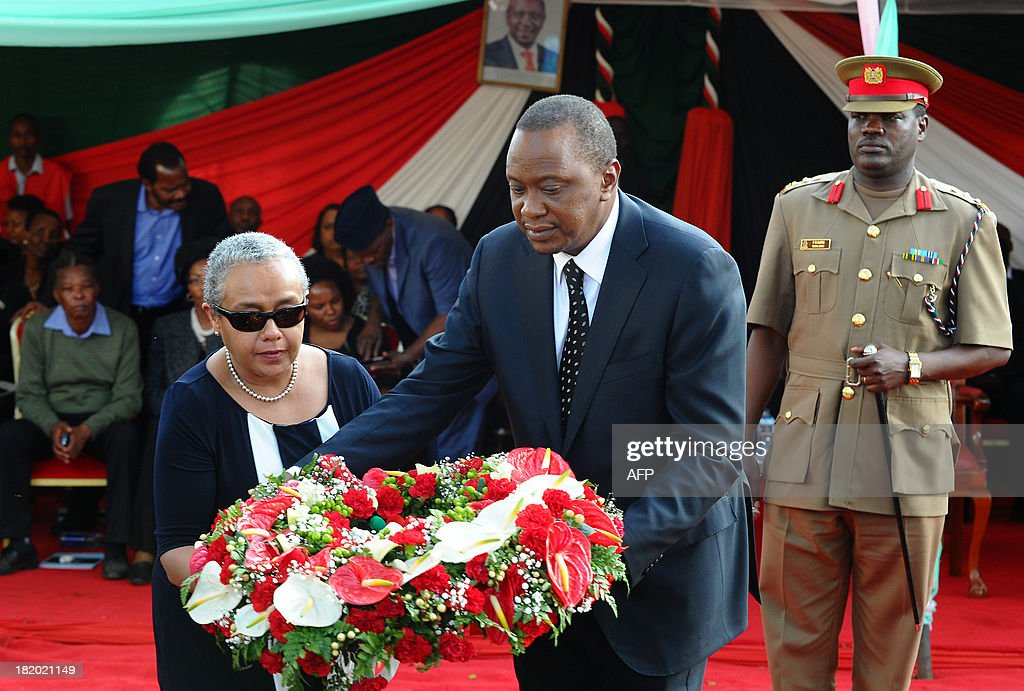 Kenyan President Uhuru Kenyatta and his wife Margaret lay a wreath of flowers during the funeral service of his nephew Mbugua Mwangi and his fiancee Rosemary Wahito in Nairobi on September 27, 2013 after they were both killed in the Westagte Mall attacks. Kenyan and foreign forensics teams scoured the wreckage of a Nairobi shopping mall for bodies and clues after a four-day siege by Islamist gunmen left 67 dead and dozens more missing.