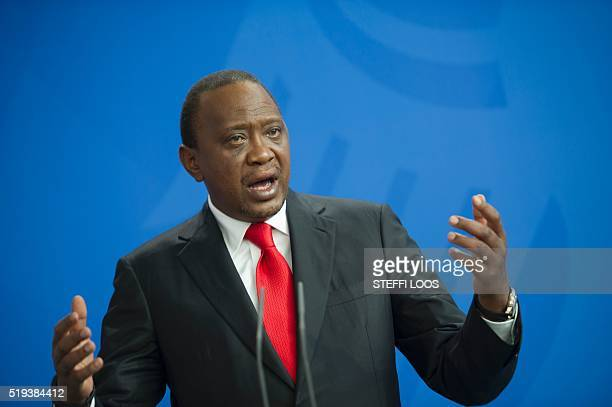 Kenyan President Uhuru Kenyatta attends a news conference with German Chancellor after a meeting at the Federal Chancellery in Berlin on April 6 2016...
