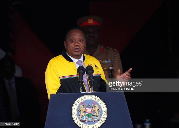Kenyan President Uhuru Kenyatta delivers a speech after he handed the national flag to the Olympics Kenyan team on July 22 2016 at the State House in...
