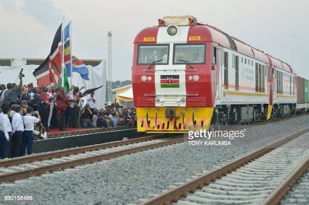 Kenyan President Uhuru Kenyatta flags off a cargo train as it leaves the container terminal at the port of the coastal town of Mombasa on May 30 2017...