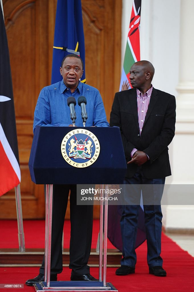 Kenyan President <a gi-track='captionPersonalityLinkClicked' href=/galleries/search?phrase=Uhuru+Kenyatta&family=editorial&specificpeople=2149190 ng-click='$event.stopPropagation()'>Uhuru Kenyatta</a> (C) flanked by Deputy President <a gi-track='captionPersonalityLinkClicked' href=/galleries/search?phrase=William+Ruto&family=editorial&specificpeople=2149191 ng-click='$event.stopPropagation()'>William Ruto</a>, addresses the Nation at the State House capital Nairobi on April 4, 2015 where he declared 3 days of national mourning following the Garissa University College terror attack and promised to support the victims. Kenyatta on Saturday warned Somalia's Al-Qaeda-linked Shebab fighters his government will respond to their killing of almost 150 students in the 'severest way' possible.
