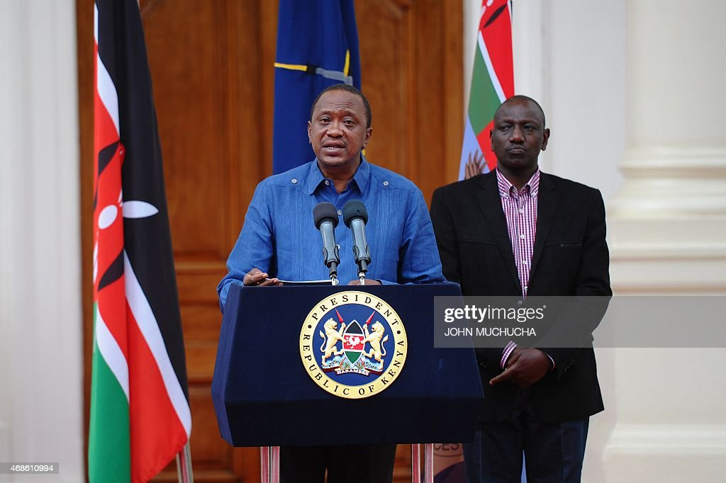 Kenyan President <a gi-track='captionPersonalityLinkClicked' href=/galleries/search?phrase=Uhuru+Kenyatta&family=editorial&specificpeople=2149190 ng-click='$event.stopPropagation()'>Uhuru Kenyatta</a> (C) flanked by Deputy President <a gi-track='captionPersonalityLinkClicked' href=/galleries/search?phrase=William+Ruto&family=editorial&specificpeople=2149191 ng-click='$event.stopPropagation()'>William Ruto</a>, addresses the Nation at the State House capital Nairobi on April 4, 2015 where he declared 3 days of national mourning following the Garissa University College terror attack and promised to support the victims. Kenyatta on Saturday warned Somalia's Al-Qaeda-linked Shebab fighters his government will respond to their killing of almost 150 students in the 'severest way' possible. AFP PPHOTO / JOHN MUCHUCHA