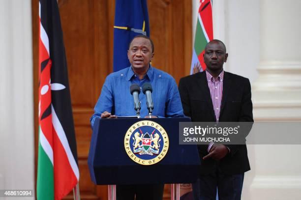 Kenyan President Uhuru Kenyatta flanked by Deputy President William Ruto addresses the Nation at the State House capital Nairobi on April 4 2015...