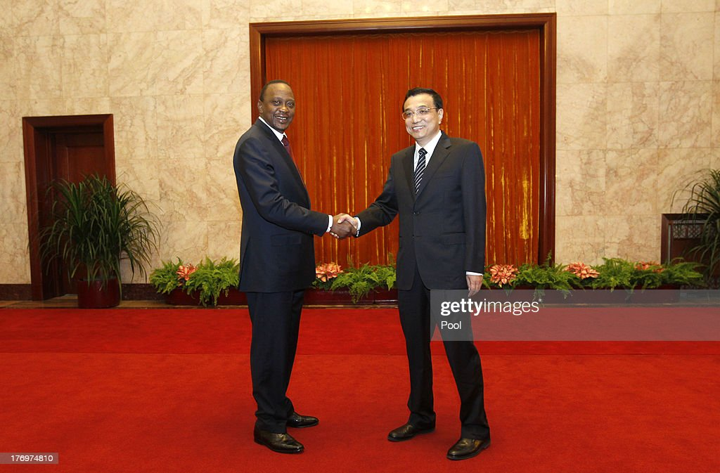 Kenyan President Uhuru Kenyatta (L) shakes hands with Chinese Premier Li Keqiang during their meeting at the Great Hall of the People August 20, 2013 in Beijing, China. An agreement was signed between the two countries that will allow mutual visa exemptions for holders of diplomatic service passports.