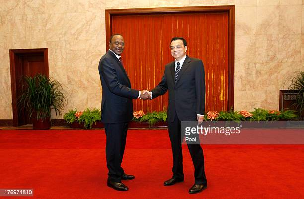 Kenyan President Uhuru Kenyatta shakes hands with Chinese Premier Li Keqiang during their meeting at the Great Hall of the People August 20 2013 in...