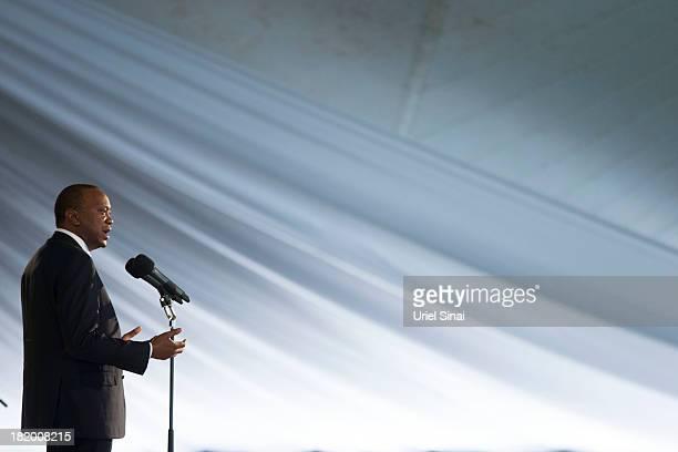 Kenyan President Uhuru Kenyatta speaks during the funeral service for his nephew Mbugua Mwangi and his fiancee Rosemary Wahito who were killed at the...