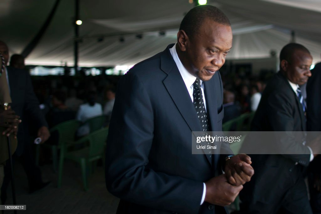Kenyan President Uhuru Kenyatta takes part in the funeral service for his nephew Mbugua Mwangi and his fiancee Rosemary Wahito who were killed at the the Westgate Mall terrorist attack on September 27, 2013 in Nairobi, Kenya. The country is observing three days of national mourning as security forces begin the task of clearing and securing the Westgate shopping mall following a four-day siege by militants.
