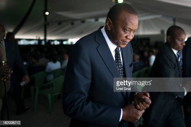 Kenyan President Uhuru Kenyatta takes part in the funeral service for his nephew Mbugua Mwangi and his fiancee Rosemary Wahito who were killed at the...
