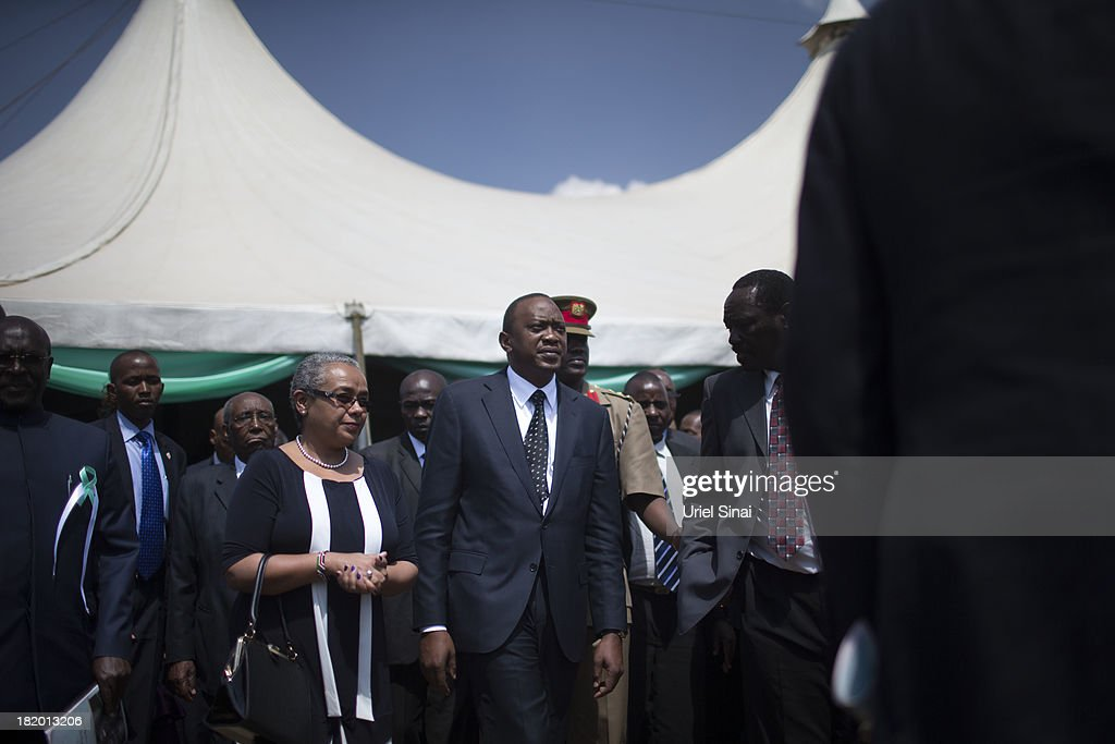 Kenyan President Uhuru Kenyatta takes part in the funeral service for his nephew Mbugua Mwangi and his fiancee Rosemary Wahito who were killed at the the Westgate Mall terrorist attack, on September 27, 2013 in Nairobi, Kenya. The country is observing three days of national mourning as security forces begin the task of clearing and securing the Westgate shopping mall following a four-day siege by militants.