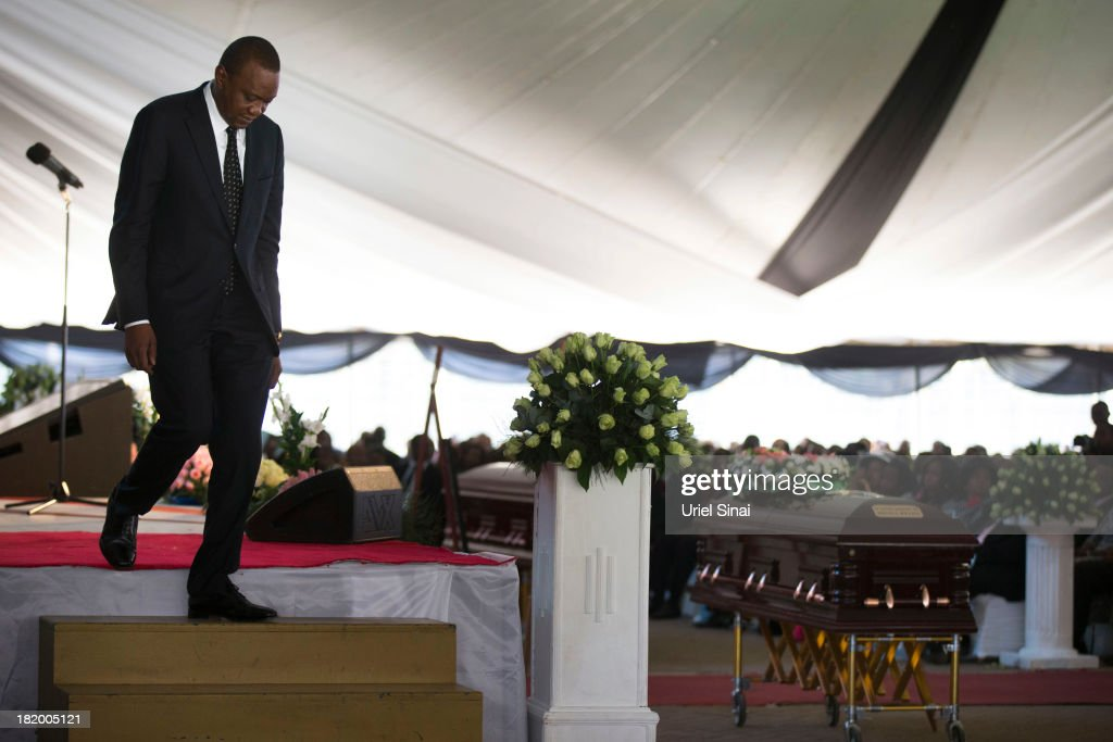 Kenyan President Uhuru Kenyatta walks down from the stage past his nephew's coffin at the funeral service for his nephew Mbugua Mwangi and his fiancee Rosemary Wahito who were killed in the Westgate Mall terrorist attack September 27, 2013 in Nairobi, Kenya. The country is observing three days of national mourning as security forces begin the task of clearing and securing the Westgate shopping mall following a four-day siege by militants.