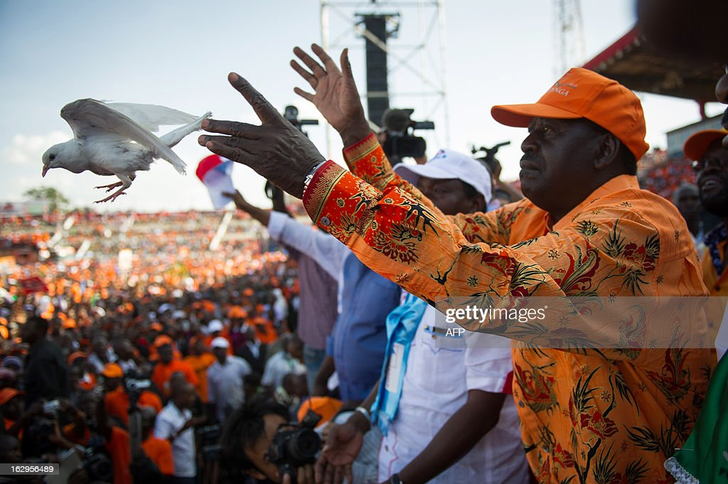 Kenyan Prime Minister and presidential candidate Raila Odinga releases a dove at a rally in Nyayo Stadium in Nairobi on March 2, 2013, on the last day of campaigning, 48 hours ahead of presidential, gubernatorial and senatorial elections.