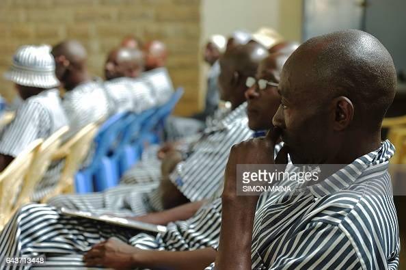 A Kenyan prisoner looks out while waiting to register to vote for the upcoming general election at the Kamiti Prison in Nairobi At least 22 million...
