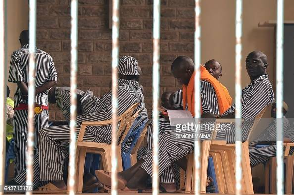 A Kenyan prisoner looks outside from a prison cell while he waits with codetainees to register with Independent Electoral and Boundaries Commission...
