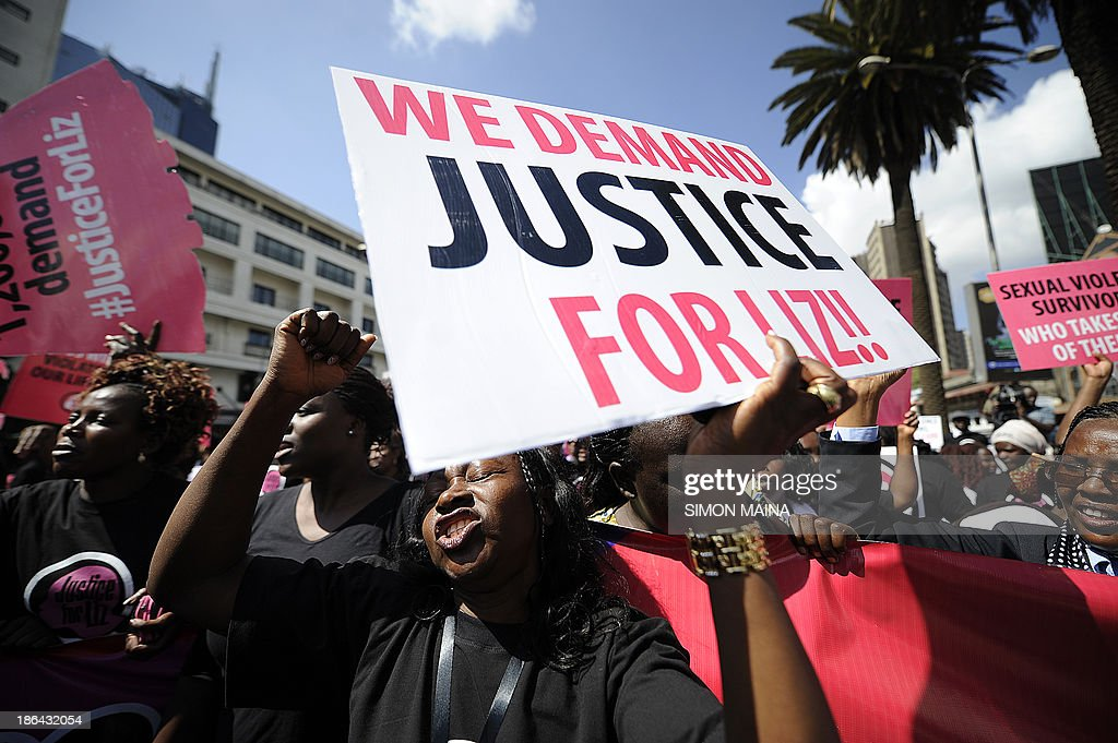 Kenyan protestors march towards the police headquarters on October 31, 2013 in Nairobi to deliver a petition of over a million names demanding justice after men accused of brutally gang raping a schoolgirl cut grass as punishment. The ferocious attack on the teenage girl and lack of action against those who carried it out has sparked outrage in the country. The 16-year-old, known by the pseudonym Liz, was reportedly attacked, beaten and then raped by six men as she returned from her grandfather's funeral in western Kenya in June, before the gang dumped her, bleeding and unconscious, in a deep sewage ditch. AFP PHOTO / SIMON MAINA
