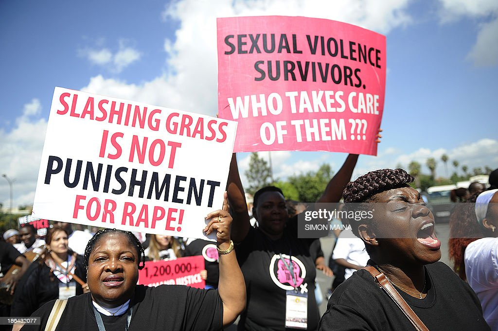 Kenyan protestors march towards the police headquarters on October 31 2013 in Nairobi to deliver a petition of over a million names demanding justice...