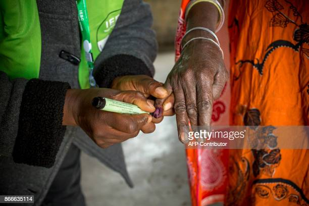 Kenyan residents from Masailand cast their ballot on October 26 as Kenya's reelection voting gets underway in Kajiado Kenyans began voting Thursday...