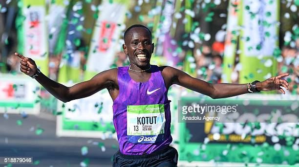 Kenyan runner Cybrian Kotut celebrates as he comes first in the race during 40th Paris Marathon in Paris France on April 03 2016