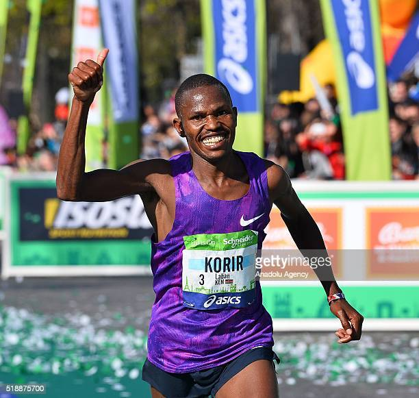 Kenyan runner Laban Korir celebrates as he comes second in the race during 40th Paris Marathon in Paris France on April 03 2016