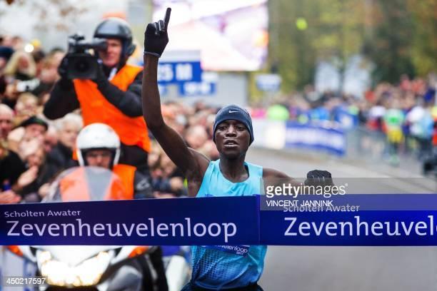 Kenyan runner Leonard Komon crosses the finish line to win the 30th edition of the Zevenheuvelenloop 15 km running race in Nijmegen on November 17...