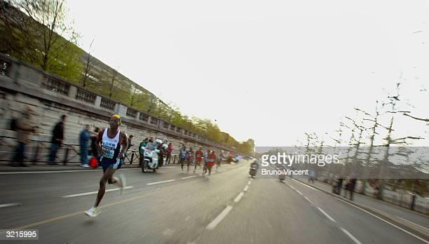 Kenyan runner Wesley Ochoro heads up the lead of the Paris Marathon on April 4 in Paris