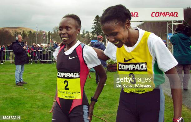 Kenyan runners and flatmates Tegla Loroupe and Joyce Chepchumba console each other after being beaten to the finish by Ireland's Sonia O'Sullivan at...