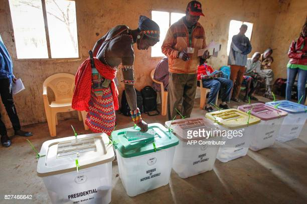 A Kenyan Samburu warrior casts his ballot at a polling station in Nkirish in the Eastern Province during general elections on August 8 2017 Kenyans...