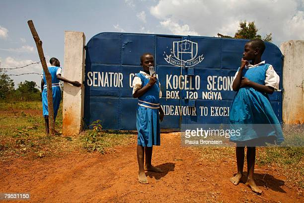 Kenyan school students stand outside gates to their school the Senator Obama Kogelo Secondary school on February 5 2008 in Kogelo Kenya The school...
