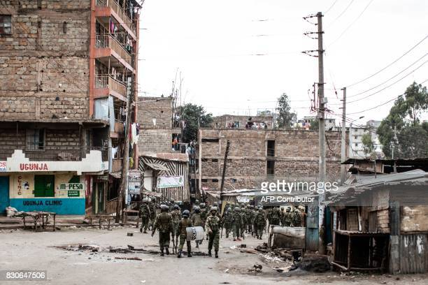 Kenyan security forces patrol in the Mathare 4a slum in Nairobi on August 12 where demonstrations continued overnight following the announcement that...