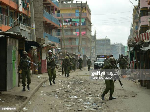 Kenyan security forces walk down a street at the Nairobi slum of Mathare in August 12 2017 during an operation to stem protests following overnight...