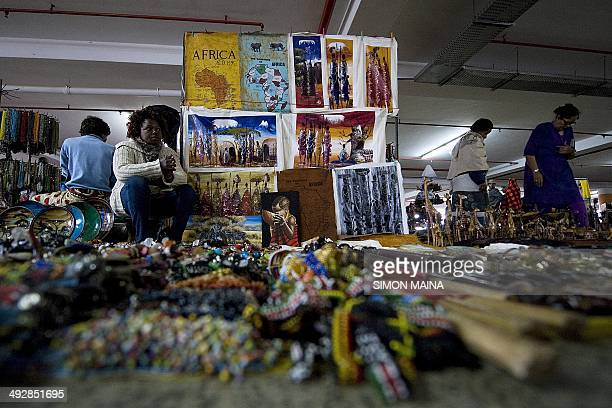 A Kenyan seller waits for clients on May 22 2014 at the Maasai market in Nairobi a few days after hundreds of British tourists have been evacuated...