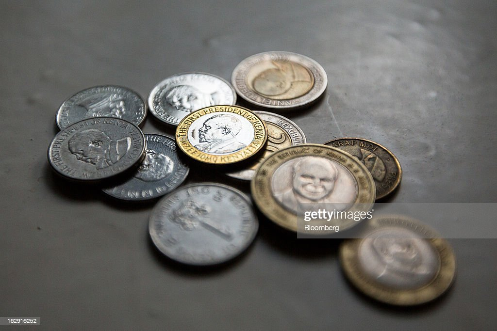 Kenyan shilling currency coins are arranged for a photograph in Nairobi, Kenya, on Friday, March 1, 2013. Next week's presidential vote will be the first since disputed elections in 2007 triggered ethnic fighting in which more than 1,100 people died and another 350,000 fled their homes. Photographer: Trevor Snapp/Bloomberg via Getty Images