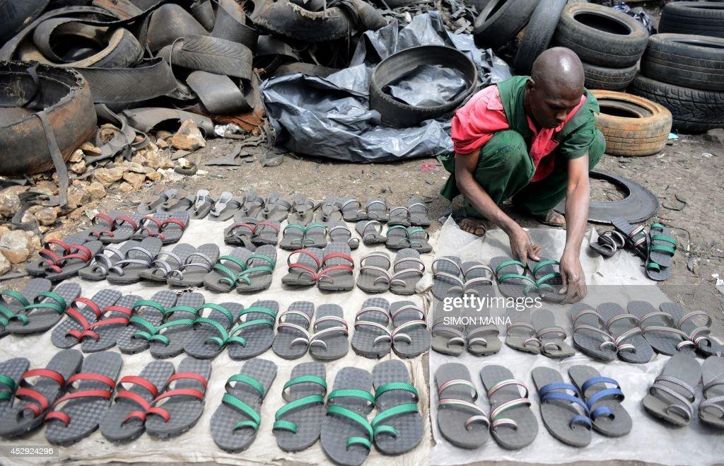 Exhibition Booths Kenya : Kenyan shoemaker munyao displays pairs of sandals locally