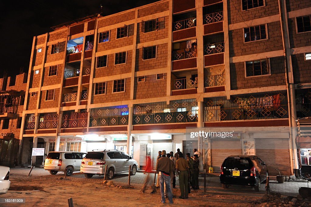 Kenyan soldiers and civilians stand in front of a building in the Somali district of Nairobi, where a blast occurred on March 5, 2013. Two blasts struck the Somali district of the Kenyan capital on March 5, leaving at least one person wounded, the Red Cross said on its Twitter feed. Nairobi police chief Benson Kibui confirmed only one explosion, saying it happened when a homemade explosive device was thrown at a kiosk, wounding a woman who was inside. 'The device landed near a bar where people had been watching the election results on television,' he added.