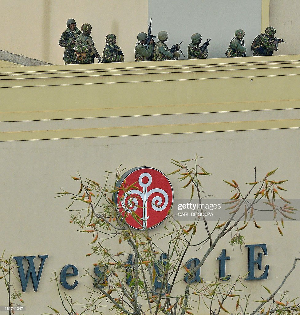 Kenyan soldiers clear the top floor balcony and interior of Westgate Mall on September 24 2013 Kenyan Defence troops remain inside the Westgate mall...
