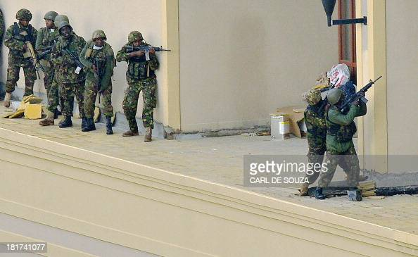 Kenyan soldiers move in formation clearing the top floor balcony and interior of Westgate Mall on September 24 2013 in Nairobi Kenyan Defence troops...