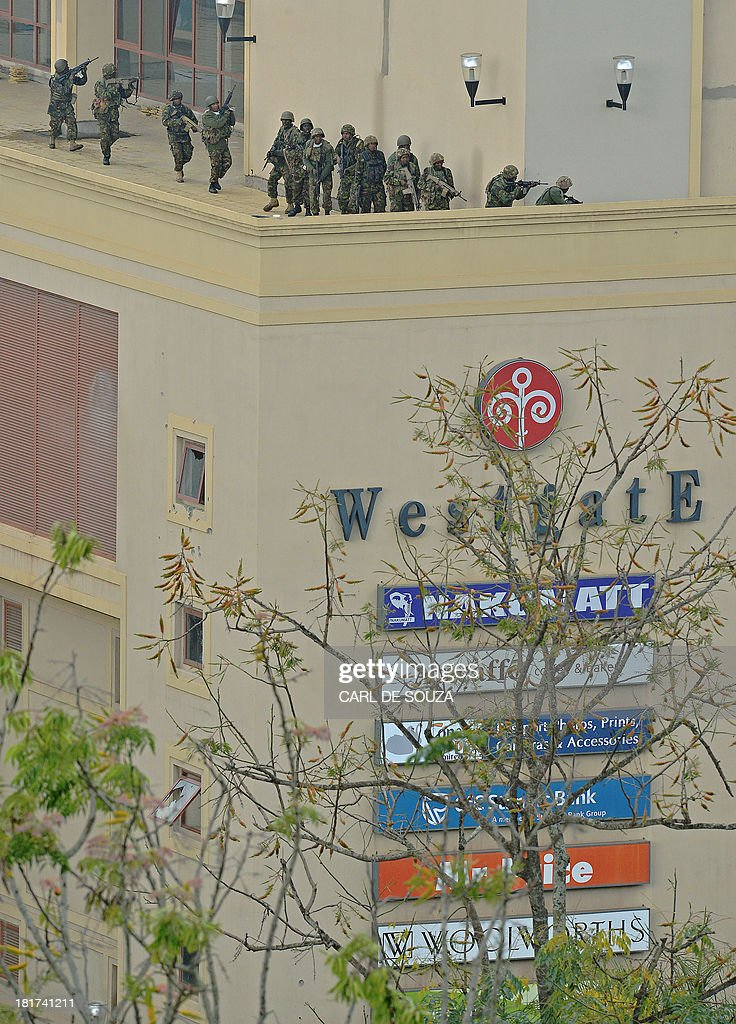 Kenyan soldiers move on September 24 2013 on the top floor balcony of Westgate Mall in Nairobi AlQaedalinked Islamist militants claiming they were...