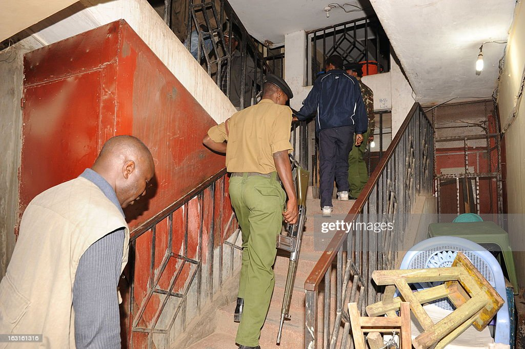 Kenyan soldiers patrol on March 5, 2013 in a block of flats in the Somali district of Nairobi, where a blast occurred earlier. Two blasts struck the Somali district of the Kenyan capital on March 5, leaving at least one person wounded, the Red Cross said on its Twitter feed. Nairobi police chief Benson Kibui confirmed only one explosion, saying it happened when a homemade explosive device was thrown at a kiosk, wounding a woman who was inside. 'The device landed near a bar where people had been watching the election results on television,' he added.