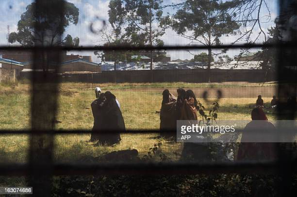 Kenyan Somali ladies are pictured through the window of a polling station in the Eastleigh district of the Kenyan capital Nairobi on March 4 2013...
