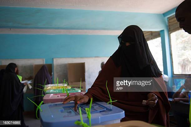 A Kenyan Somali lady casts her ballot papers in the Eastleigh district of the Kenyan capital Nairobi on March 4 2013 during the nationwide elections...