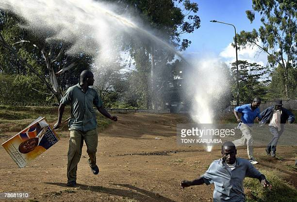 Kenyan supporters of the Orange Democratic Movement presidential candidate Raila Odinga run 31 December 2007 from police water cannons at Kibera slum...