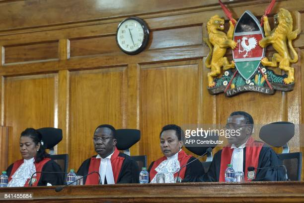 Kenyan Supreme Court judges rule over an opposition petition challenging the result of the August 8 presidential election in Nairobi on September 1...