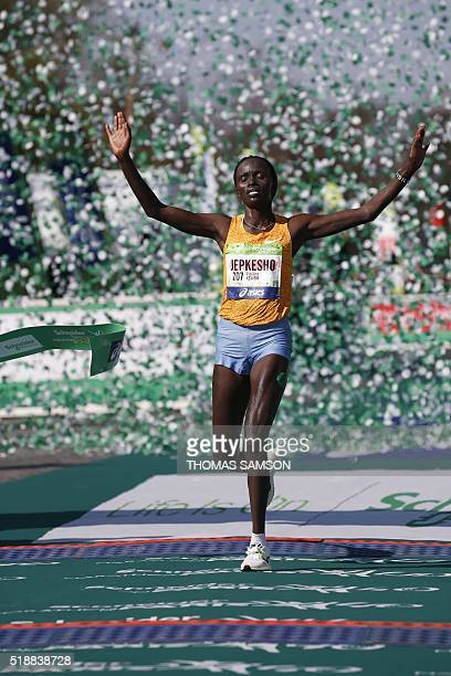Kenyan Visiline Jepkesho passes the finish line as she wins the 40th Paris Marathon on April 3 2016 in Paris Some 57000 participants from 160...