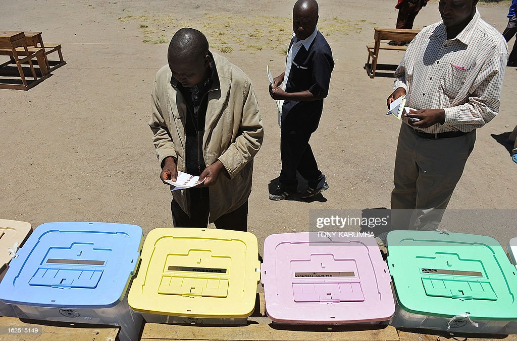 Kenyan voters participates in a nation-wide mock election organised by the Independent Electoral and Boundaries Commission (IEBC) at a polling station in Kajiado, some 130 km southwest of Nairobi on February 24, 2013. The IEBC runs the rehearsal eight days from Kenya's national elections viewed with an equal share of emotion and apprehension both locally and internationally and will be the first since bloody post-poll ethnic clashes that resulted in more than a thousand deaths. Presidential candidates in next week's poll made a rare show of unity to rally Kenyans to vote peacefully and avoid violence witnessed during the last general election. AFP PHOTO/Tony KARUMBA