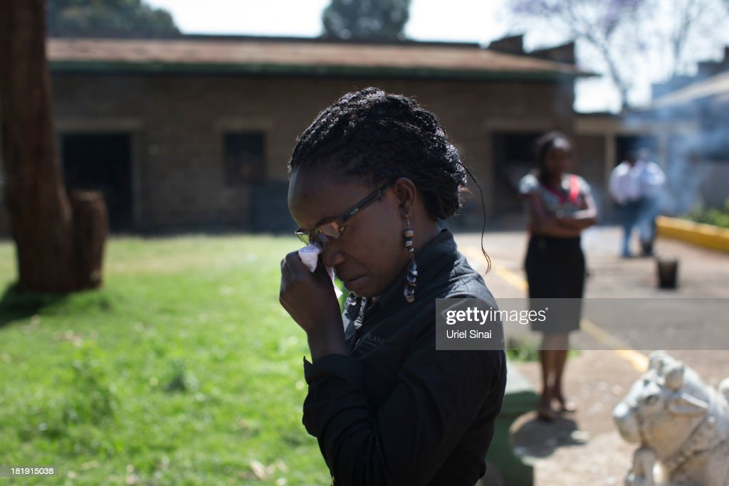 Kenyan woman cries during the funeral ceremony of Sridhar Natarajan who was killed at the at the Westgate Mall attack on September 26 2013 in Nairobi...
