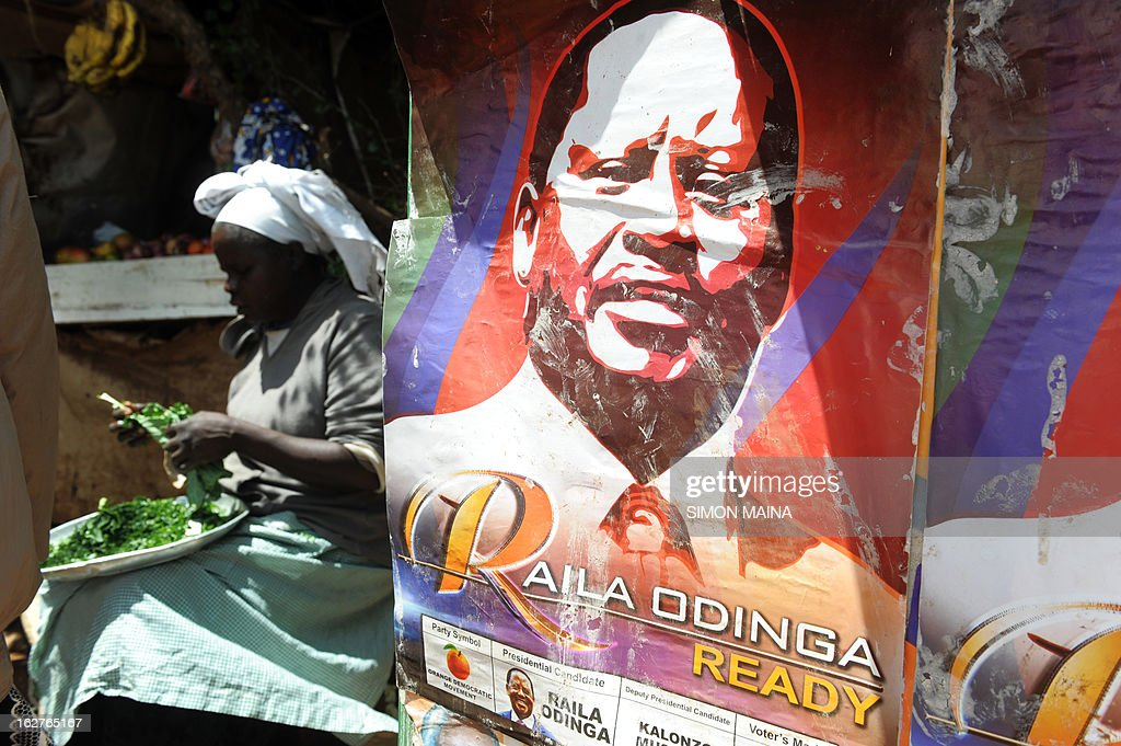 A Kenyan woman eats vegetables for lunch next to a poster advertising Presidential candidate and Prime Minister Raila Odinga on February 26, 2013 in the sprawling Kibera slums. Kenya is gearing up for presidential, gubernatorial, senatorial elections on March 4, the first since bloody post-poll violence five years ago in which more than 1,100 people died after contested results.