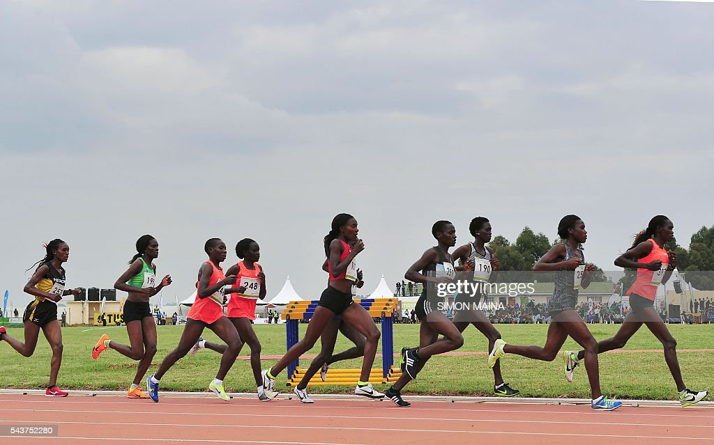 Kenyan women athletes compete in the 10,000 meters final on June 30, 2016 in Eldoret, during the trials for Rio Olympics games. MAINA