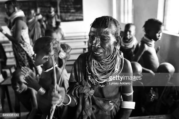 Kenyan women dance in the local school which doubles as a church in the village of Mayen Turkana Kenya on Aug 15 2011