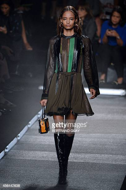 Kenyanborn British model Malaika Firth presents a creation for Louis Vuitton during the 2015 Spring/Summer readytowear collection fashion show on...